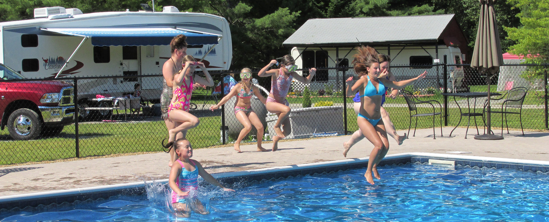 Girls jumping in the pool